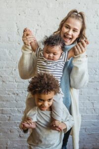 mother with black sons near brick white wall